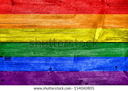 Rainbow Flag painted on old wood plank background
