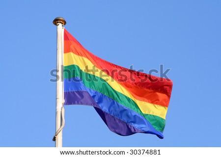 Rainbow flag with a blue background