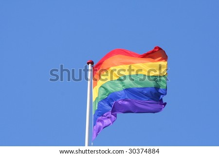 Rainbow flag with a blue background