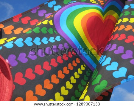 Rainbow flag with rainbow heart #1289007133