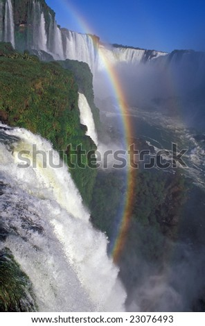 Rainbow formed by the spray of Iguacu Falls, Brazil.