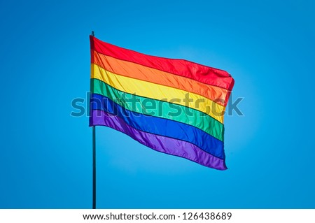 Rainbow Gay Pride Flag on blue sky background, Miami Beach, Florida, USA