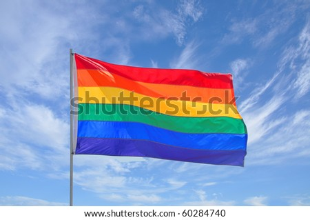 Rainbow Gay Pride Flag on Cloudscape Background