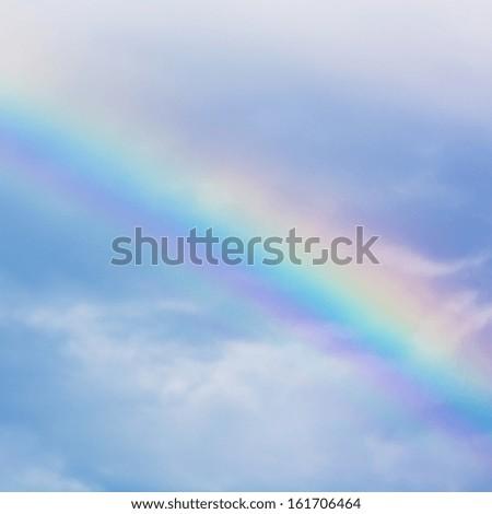 Rainbow gradient strip light colorful clouds against blue sky