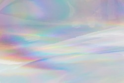 Rainbow halographic wrinkled foil background. Abstract pastel color background.