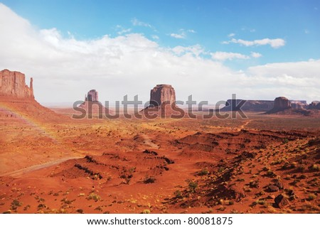 Rainbow in a red desert. Monument Valley after the rain