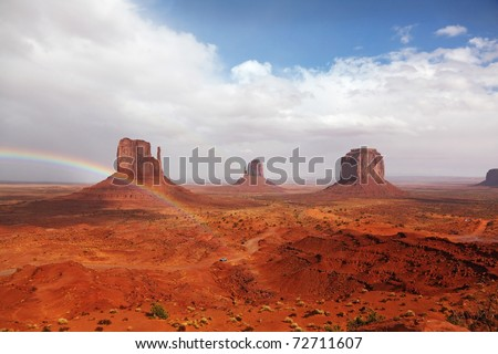 "Rainbow in a red desert. The famous ""Mittens"" in Monument Valley after the rain"
