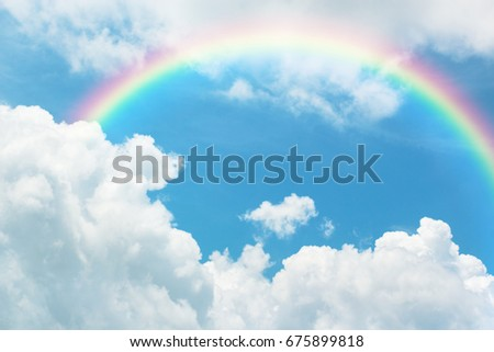 Rainbow in Blue sky with cloud. #675899818