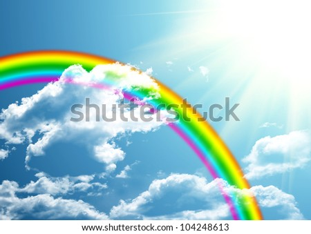 Rainbow in clouds and to the blue sky