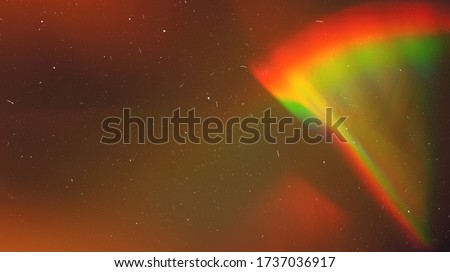 Photo of  Rainbow Lens Optical Flare Film Dust Overlay Effect Vintage Abstract Bokeh Light Leaks Photo Retro Camera Defocused Blur Reflection Bright Sunlights. Use Screen Overlay Mode for Photo Processing.