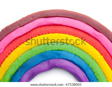 Rainbow made from dough, isolated on white.