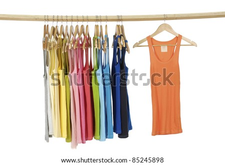 rainbow many Long colorful shirt hanging on wooden hangers