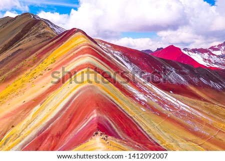 Rainbow Mountain, Peru. Rainbow Mountain is a mountain in Peru with an altitude of 5200 meters above sea level. The colorful mountain is a popular tourist destination accessed on a day trip from Cusco