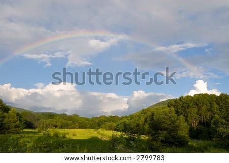 Rainbow. Nature. Foothills.Evening.