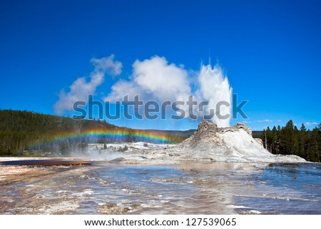 Rainbow near Castle geyser, Yellowstone National Park, Wyoming, USA