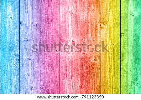 Rainbow neon colored wood background