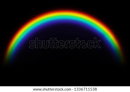 Rainbow on a black background.Rainbow icon. Shape arch isolated on black background. Colorful light and bright design element.