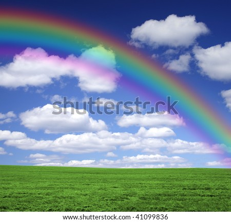 Rainbow over a green field