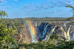 rainbow over landscape of Ruacana Falls on the Kunene River in Northern Namibia and Southern Angola border, Africa wilderness landscape