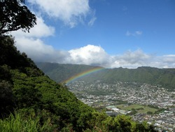 Rainbow over Manoa town on the island of Oahu seen from Tantalus Mountain.