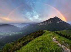 Rainbow over mountain peak