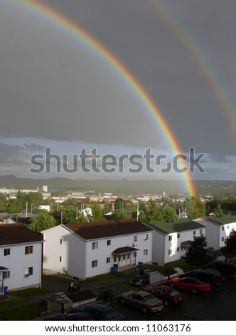 rainbow over residential housing