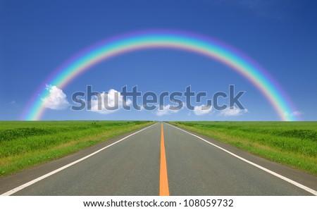 Rainbow over straight road