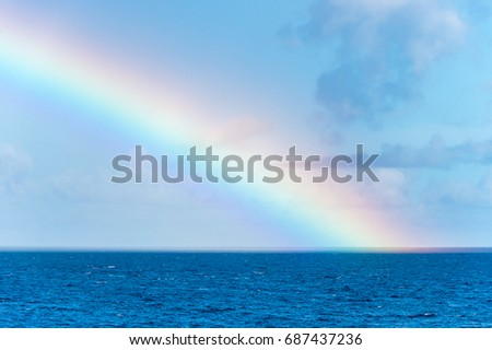 Rainbow over the Caribbean Sea in Martinique #687437236