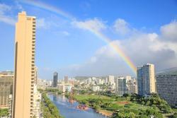 Rainbow over the city Oahu Hawaii