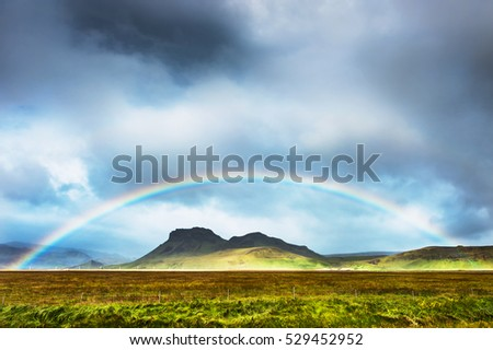 Rainbow over the mountains, South Iceland. Summer landscape  #529452952