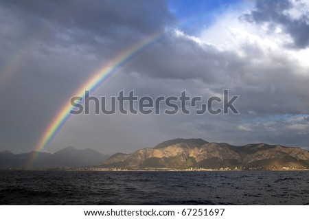 Rainbow over the sea and the island