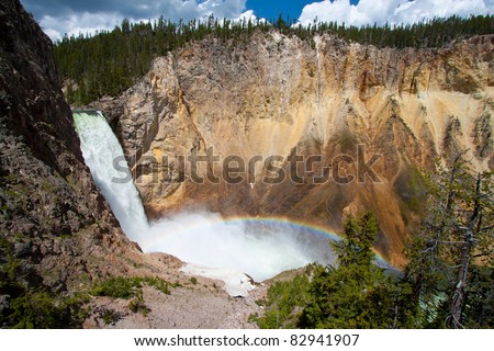 Rainbow over the waterfall in the Grand Canyon of the yellowstone national park, WY