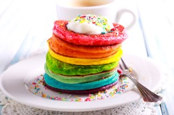 Rainbow pancakes, served in pile on plate