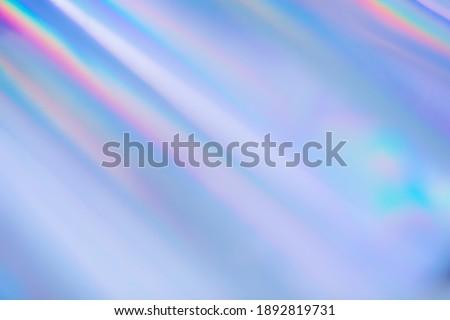 Rainbow prism light rays holographic disco background