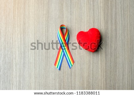 Rainbow ribbon awareness for LGBT  and homosexual community pride concept #1183388011