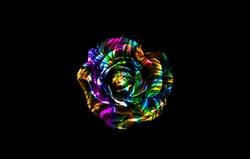 Rainbow rose isolated on black background. Rainbow flower isolated on black. Rainbow floral background. Colorful floral background. Colorful rose isolated on black.
