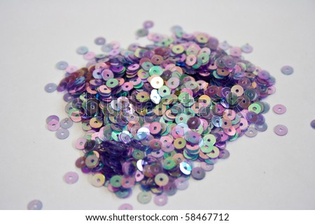 http://image.shutterstock.com/display_pic_with_logo/622174/622174,1280987812,1/stock-photo-rainbow-sequins-58467712.jpg