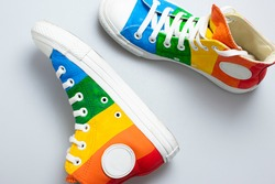 Rainbow sneakers. Multicolored sport shoes.