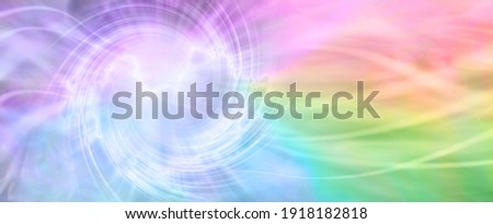 Rainbow Spiralling Vortex Background Banner - beautiful ethereal radiating gaseous energy  field with a spiral on left side with streams of energy trailing across to the right side and space for  copy Photo stock ©