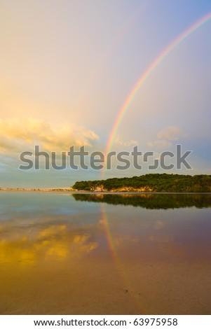 Rainbow Sunrise over the pristine New River Lagoon, Southwest National Park, Tasmania, Australia
