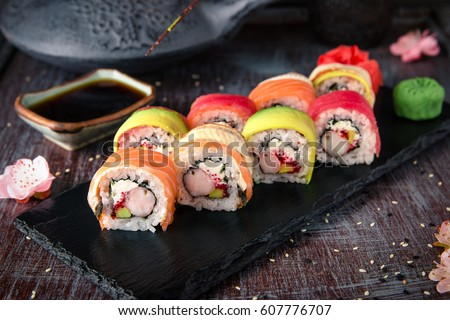 Shutterstock Rainbow Sushi Roll with salmon, eel, tuna, avocado, royal prawn, cream cheese Philadelphia, caviar tobica, chuka. Sushi menu. Japanese food.