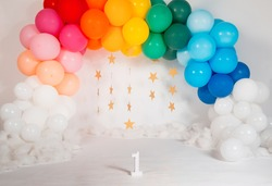 rainbow theme balloons arch for first birthday shoot