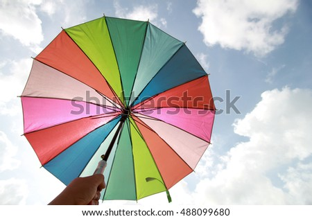 Rainbow umbrella under blue sky #488099680