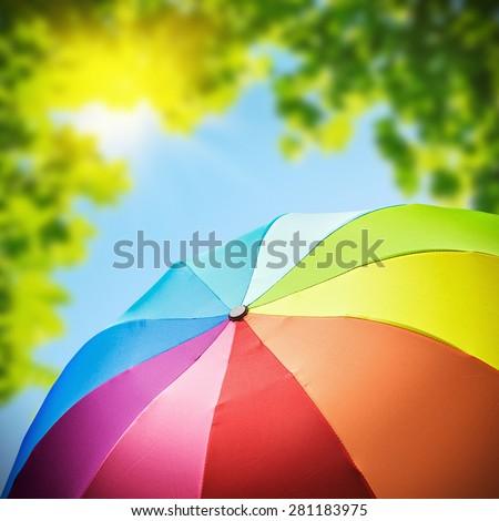 Rainbow umbrellas against the backdrop of nature. focus on umbrella