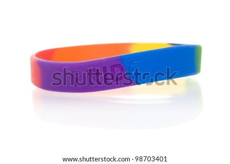 """Rainbow wristband inscribed with the word """"pride"""" (not a brand name). - stock photo"""