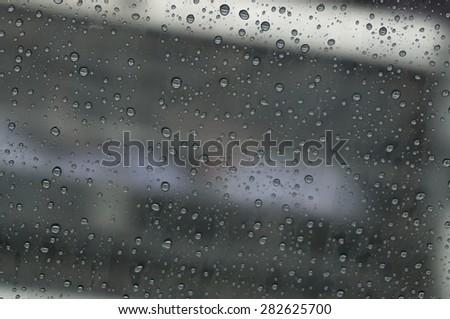 raindrop at window car on daytime that has blur background #282625700