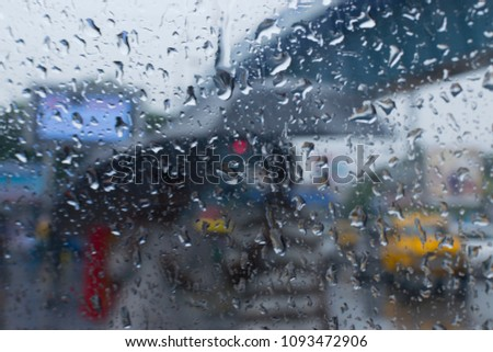 Raindrops falling on glass, abstract blurs - monsoon stock image of Kolkata (formerly Calcutta) city , West Bengal, India
