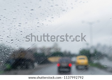 """Raindrops falling on glass, abstract blurs - monsoon stock image of Kolkata (formerly Calcutta) city , West Bengal, India. Kolkata is also called """"City of joy"""". #1137992792"""