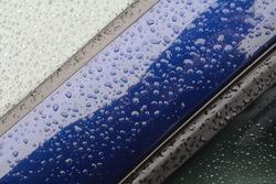 Raindrops on a car, Suffolk, England, UK - 2020