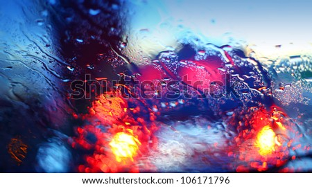 Raindrops on a car windscreen - stock photo
